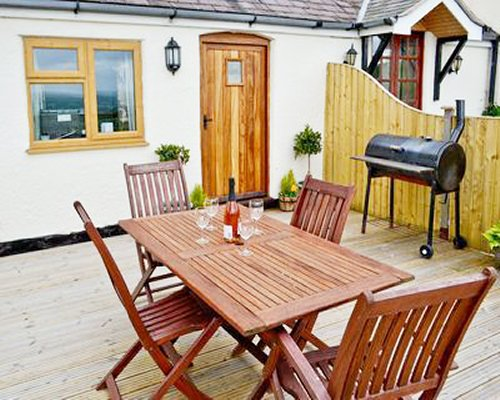 Outdoor dining with barbecue grill outdoor a unit at Ty Nain.