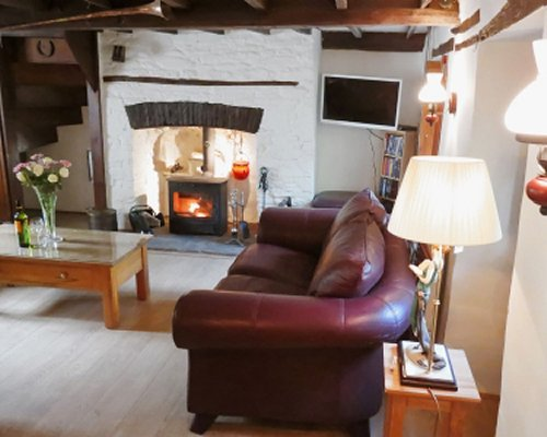 An interior view of living area with fireplace and television.
