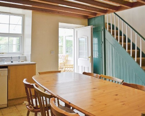 An open plan kitchen and dining area with a stairway.