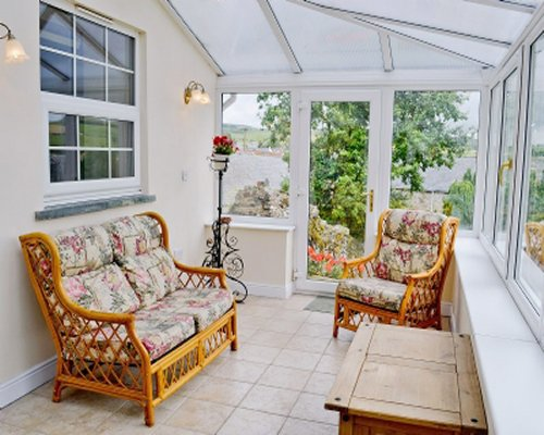 A well furnished living room with patio.