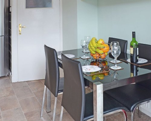 Indoor dining with fruits and beverage on the table.