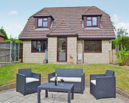 An outdoor patio alongside a cottage unit.