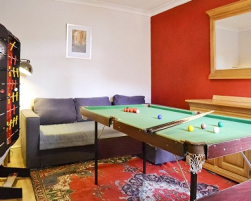 An indoor recreation room with pool table.