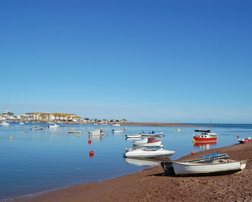 View of the beach and water with boats.