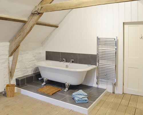 A bathroom with bathtub and shower.
