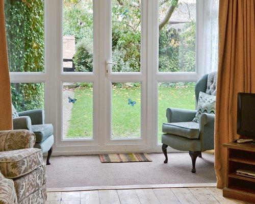 A well furnished living room alongside patio.