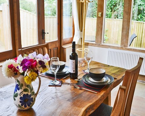 A well furnished dining room with an outside view.