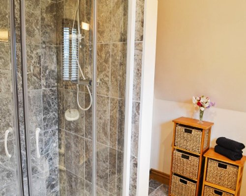 A bathroom with stand up shower.