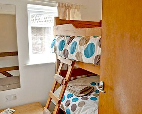 A bedroom with bunk beds and an outside view.