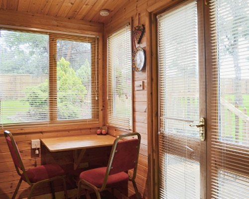 A corner dining area with window views.