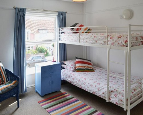 A well furnished bedroom with a bunk bed and outside view.