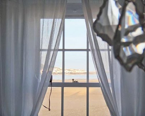 View of the beach from a window.