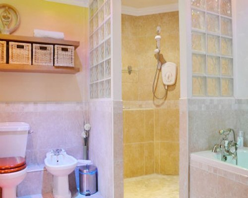 A bathroom with shower bathtub and shower stall.