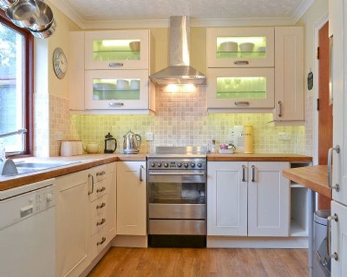 A bright well equipped kitchen with window view.