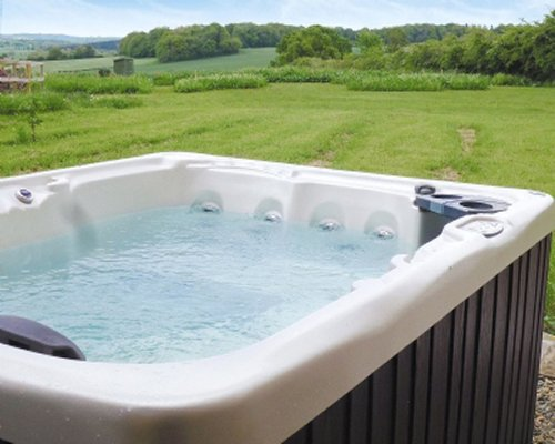 A outdoor hot tub with scenic view of countryside.
