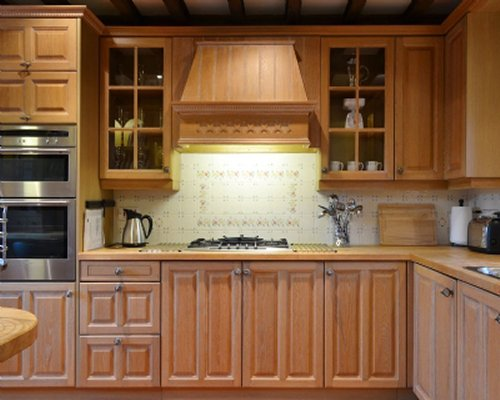 A well equipped kitchen with lots of cabinets.