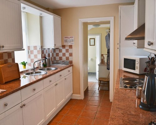 A well equipped kitchen with microwave oven.