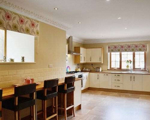 A well equipped kitchen and counter dining area.
