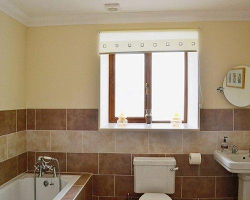A bathroom with sink and bathtub.