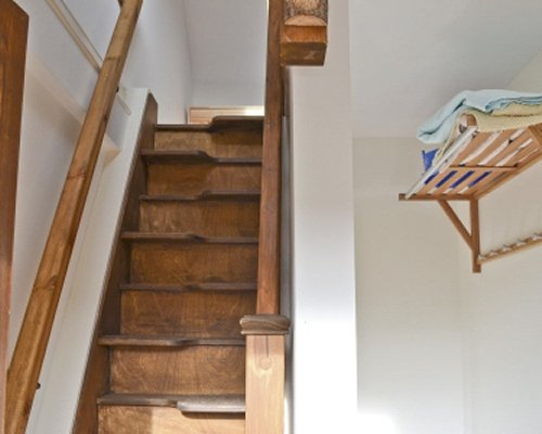 A wooden staircase with handrails.