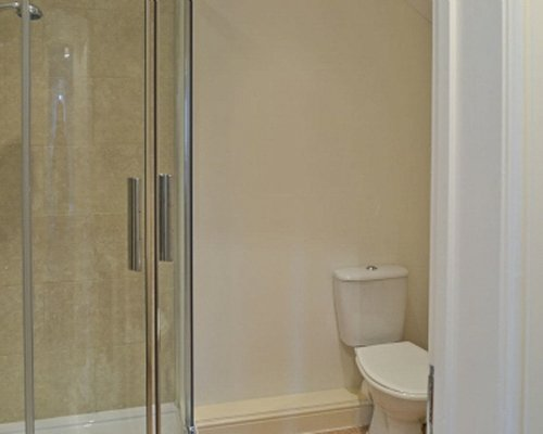 A bathroom with shower stall.