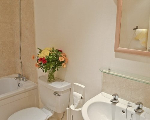 A bathroom with bathtub and sink.