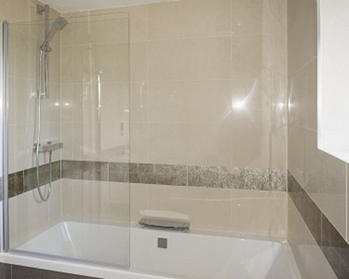 A bathtub and shower.