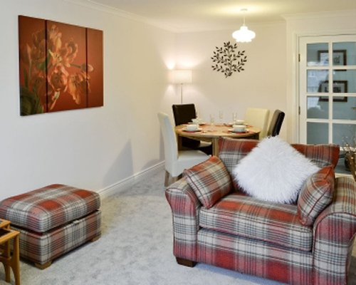 A well furnished living room with an open plan dining area.