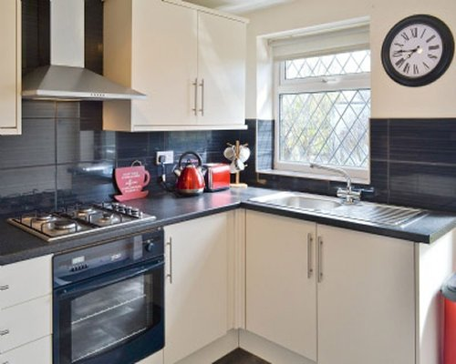A well equipped kitchen with a window.