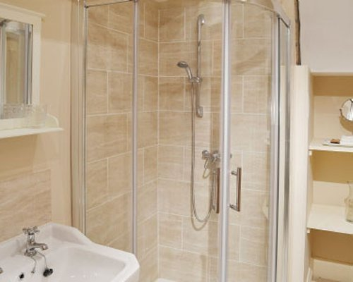A bathroom with a shower stall.