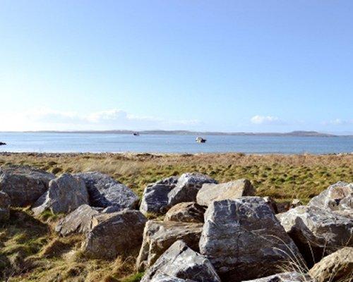 View of the sea alongside rocks.