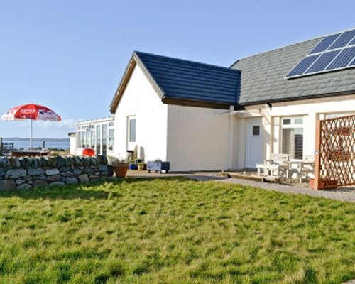 Scenic exterior view of Ferry Farm Gigha Cottage.