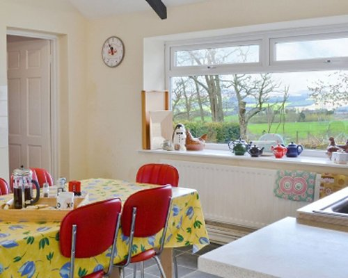 An open plan kitchen and dining area with outside view.