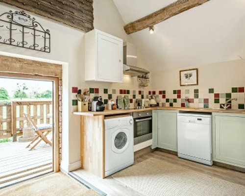 An open plan kitchen with patio.