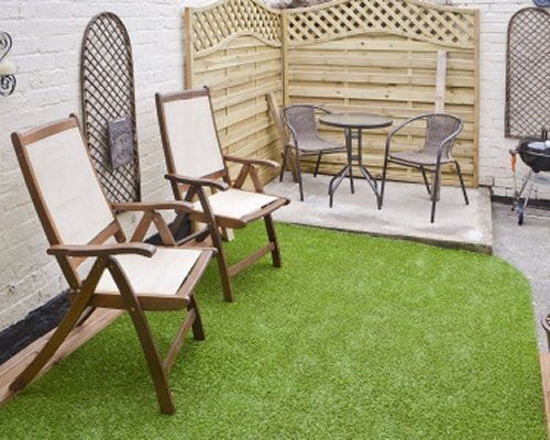 An outdoor area with patio furniture.