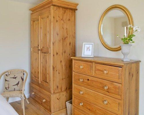 A dresser and wardrobe.