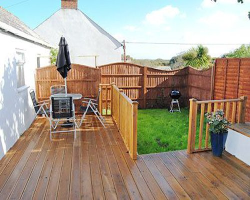 A wooden deck with patio.