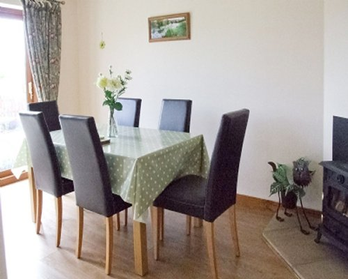 A dining table with green table cloth.
