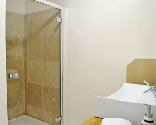 An bathroom with stand up shower.