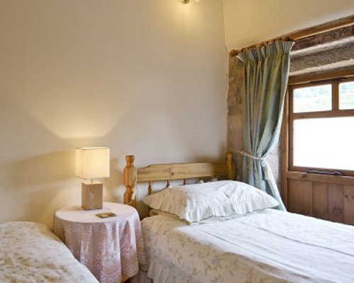 A bedroom with twin beds and a window.