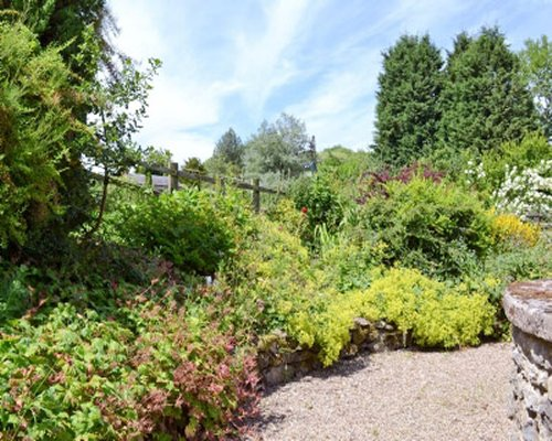 A gravel walkway with landscaped garden views.