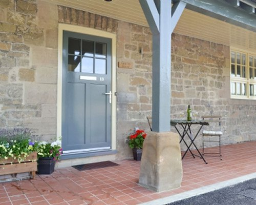 An exterior view of Abacus cottage with patio.