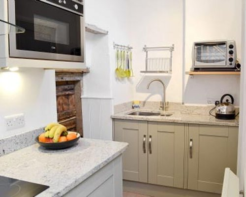 A well equipped kitchen with a microwave.