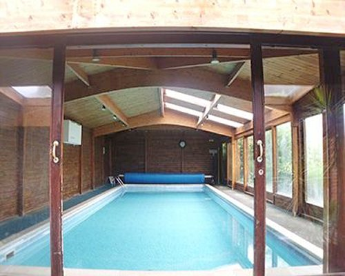An indoor swimming pool with windows.