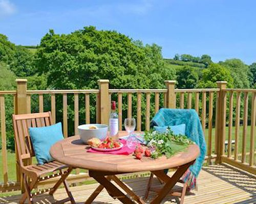 A deck with table seating and views of countryside.