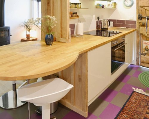 A well equipped kitchen with view of peninsula and seating area.