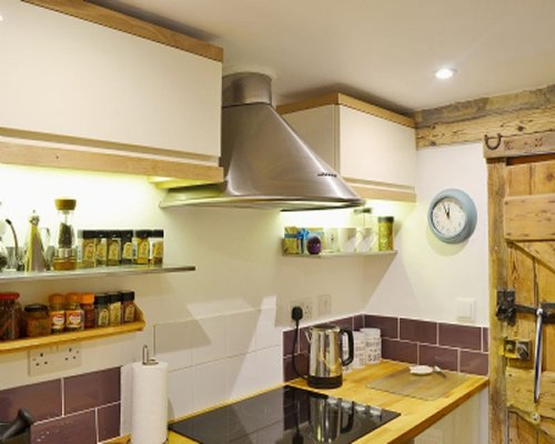 A well equipped kitchen with view of stove top area.