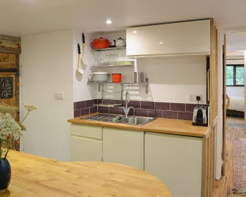 A well equipped kitchen with view of sink area.