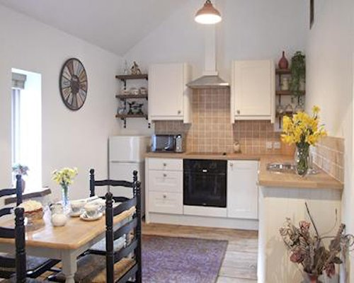 A well equipped kitchen with dining table.