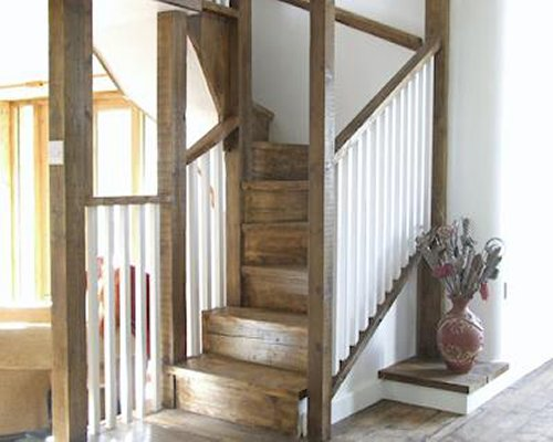 A wooden staircase to second floor.